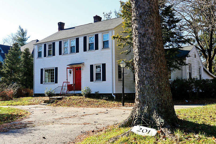 Hour photo / Erik Trautmann Recently cleaned property at 201 West Norwalk Rd. There are sixty Norwalk properties cited under city's blight ordinance. Members of Common Council's Ordinance Committee are discussing strengthening the ordinance.