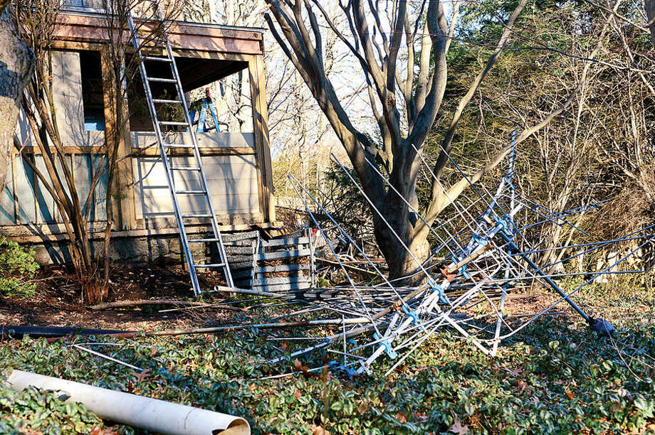 Hour photo / Erik Trautmann An old television antenna and scrap metal in the side yard of 10 Richmond Hill Rd. There are sixty Norwalk properties cited under city's blight ordinance. Members of Common Council's Ordinance Committee are discussing strengthening the ordinance.
