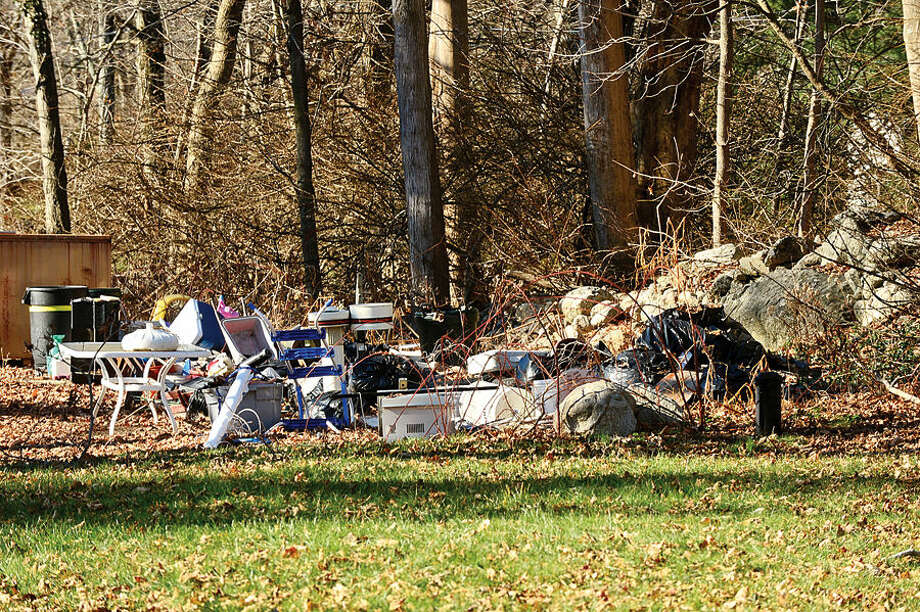 Hour photo / Erik Trautmann A property at 201 West Norwalk Rd that was cited for blight violations still has a pile of refuse in the side yard. There are sixty Norwalk properties cited under city's blight ordinance. Members of Common Council's Ordinance Committee are discussing strengthening the ordinance.