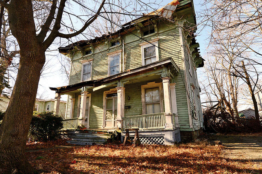 Hour photo / Erik Trautmann A run down Victorian era home at 61 Osborne Ave. There are sixty Norwalk properties cited under city's blight ordinance. Members of Common Council's Ordinance Committee are discussing strengthening the ordinance.