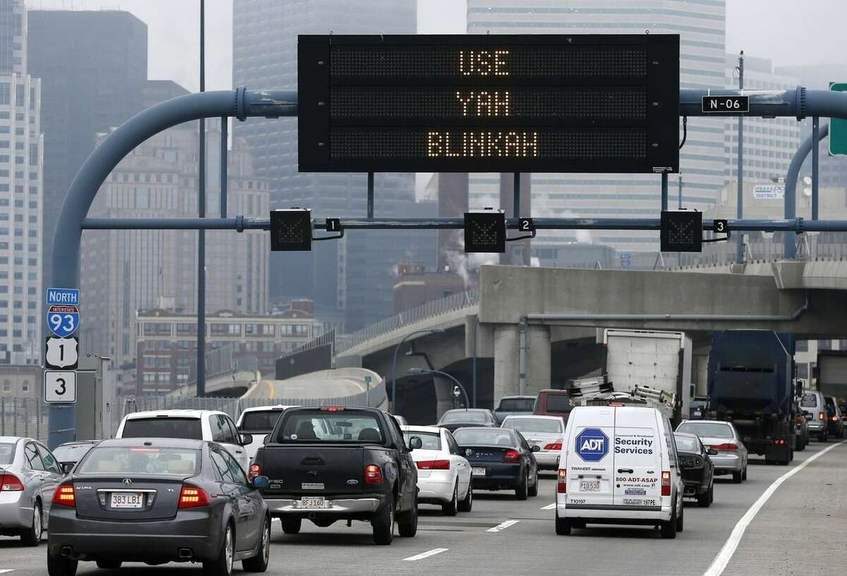 """FOR RELEASE FRIDAY, DECEMBER 26, 2014, AT 12:01 - FILE-- In this May 9, 2014 photograph, an electronic highway sign on Interstate 93 shows the term """"Use Yah Blinkah"""" in Boston. The Massachusetts Department of Transportation posted the message """"Changing Lanes? Use Yah Blinkah"""" on the signs around the city. """"Blinkah"""" is how Bostonians pronounce """"blinker"""". (AP Photo/Michael Dwyer, File)"""