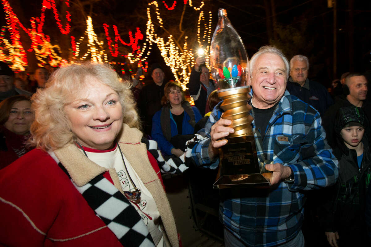 """Hour photo/Chris Palermo. The Setti's celebrate winning ABC's """"Light Fight"""" competition surrounded by family, friends, and supporters Monday night."""