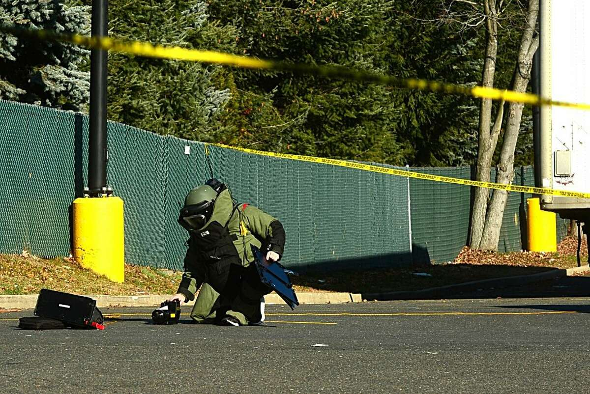 Hour photo/Erik Trautmann Norwalk Police and the Stamford Bomb Squad investigate a suspicious package at the Connecticut Avenue Walmart Saturday afternoon.