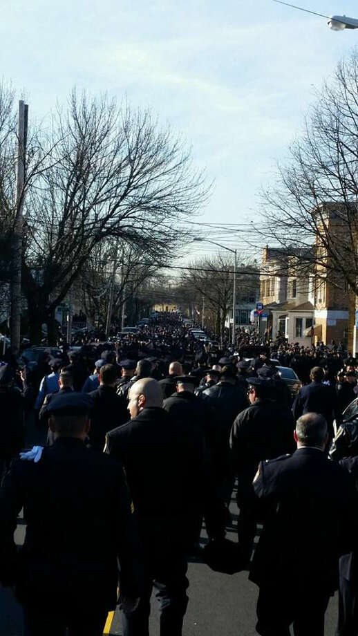 Contributed photoOver twenty members of the Norwalk Police Department attended the funeral of NYPD Officer Rafael Ramos in Queens on Saturday.