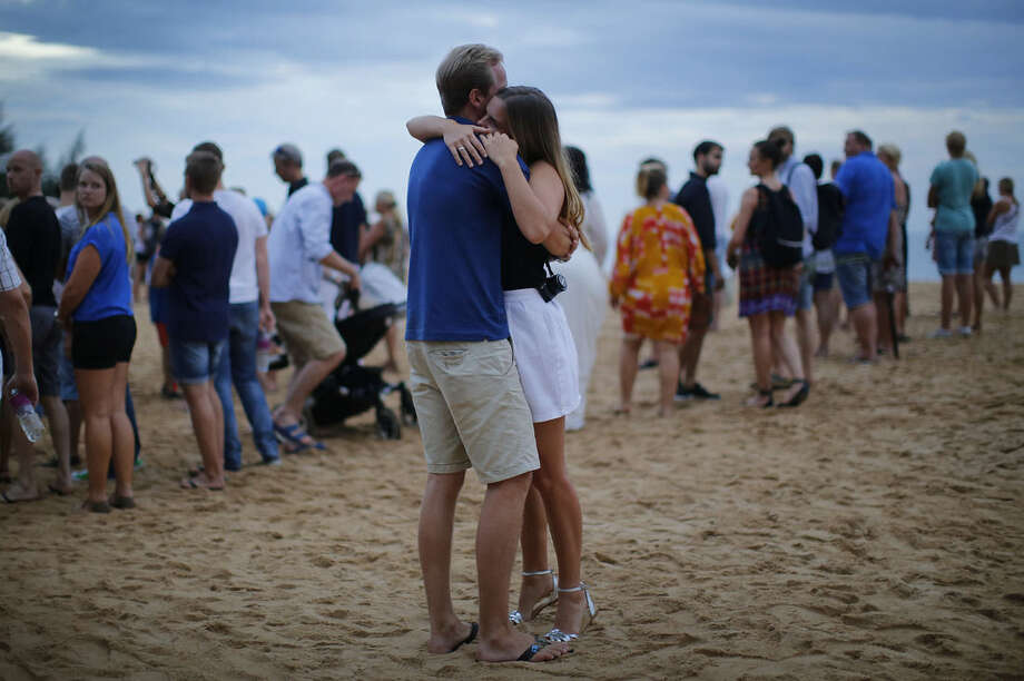 A couple embrace during a commemoration ceremony for the Swedish victims of the Asian tsunami, Friday, Dec. 26, 2014 in Khao Lak, Thailand. Dec. 26 marks the 10th anniversary of one of the deadliest natural disasters in world history: a tsunami, triggered by a massive earthquake off the Indonesian coast, that left more than 230,000 people dead in 14 countries and caused about $10 billion in damage. (AP Photo/Wong Maye-E)