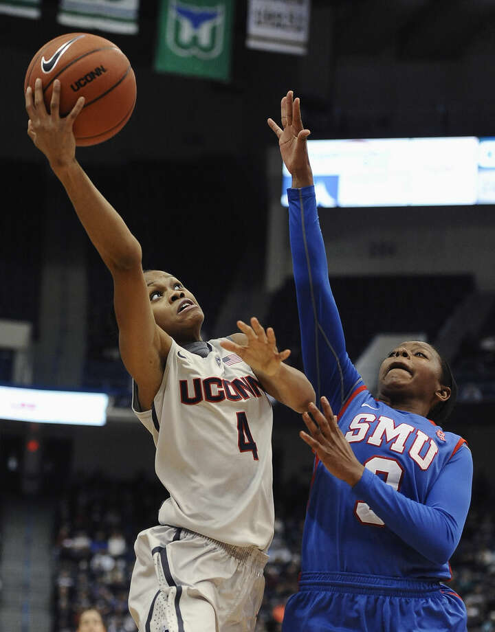 Connecticut's Moriah Jefferson, left, shoots over SMU's Gabrielle Wilkins, right, during the first half of an NCAA college basketball game, Saturday, Dec. 27, 2014, in Hartford, Conn. (AP Photo/Jessica Hill)