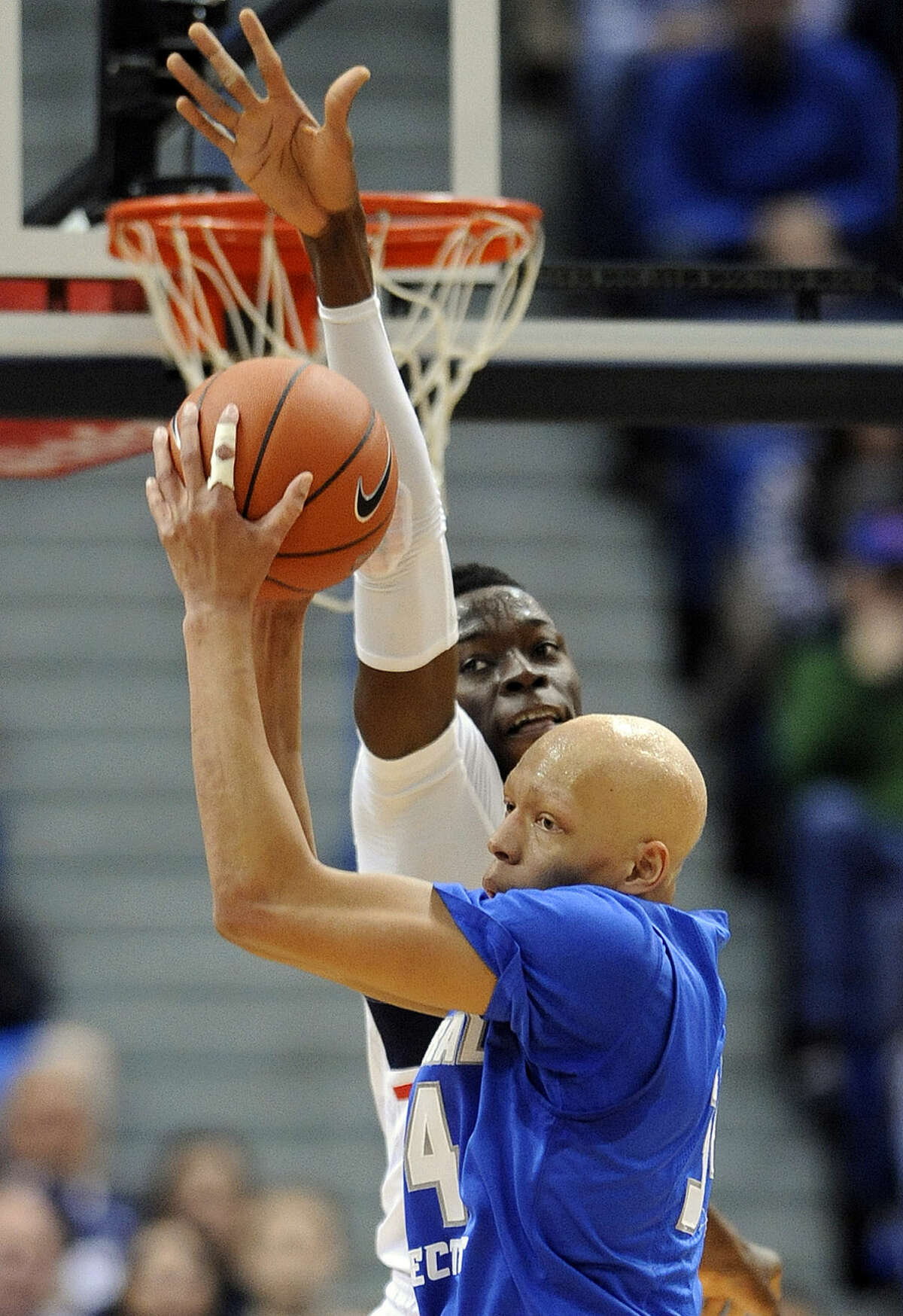 Central Connecticut State's Brandon Peel, forground, grabs a rebound from Connecticut's Amida Brimah (35) during the first half of an NCAA college basketball game in Hartford, Conn., on Sunday, Dec. 28, 2014. (AP Photo/Fred Beckham)