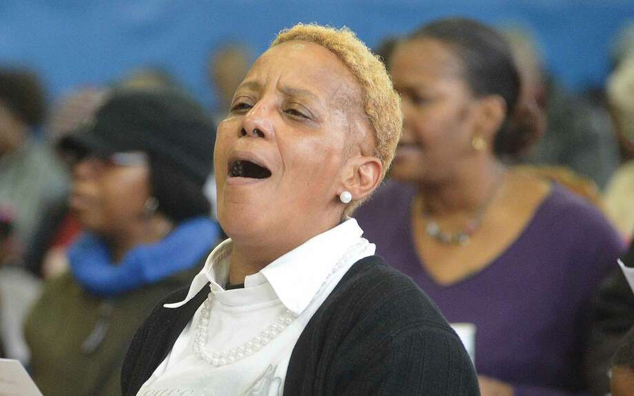 Hour Photo/Alex von Kleydorff Rose Mary Fortt sings along with everyone, The National Black Anthem 'Lift Every Voice' during the Martin Luther King Jr. Annual March and Program at The Yearwood Center in Stamford monday