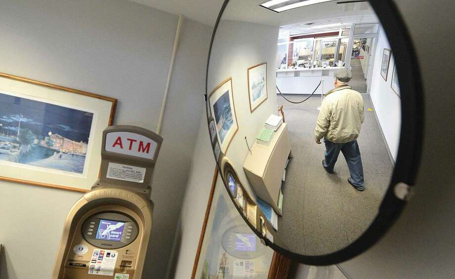 Hour Photo/Alex von Kleydorff Reflected in a security mirror, no lines at the Tax Collector's office at City Hall on Monday morning.