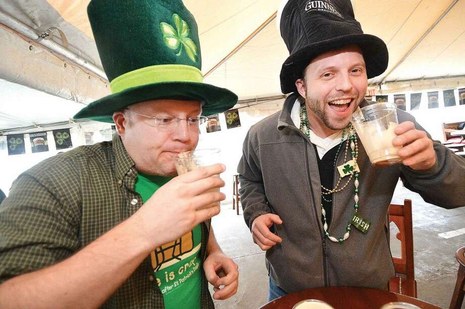Hour Photo/Alex von Kleydorff. Robert Beattie and Scott Sabo get to the bottom of some Irish Car Bomb cocktails at O'Neills Pub in Norwalk on St. Patricks Day