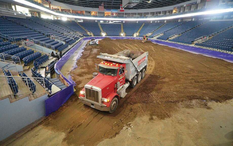 Hour Photo/Alex von Kleydorff One of some 100 trucks that delivered dirt to The Webster Bank Arena leaves after placing it on the arena floor for this weekends Monster Jam.