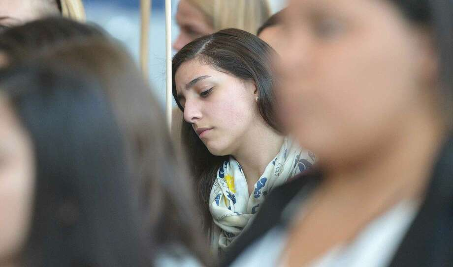 Hour Photo/Alex von Kleydorff Brien McMahon Sophmore Nathaly Hernandez listens quietly in the crowd as some of the numbers are called out during National Teen Dating Violence Awareness and Prevention Month program at the Stamford Government Center