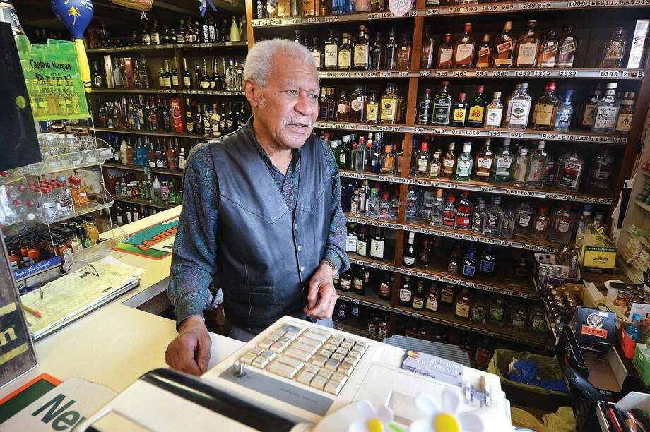 Hour Photo/Alex von Kleydorff . Harold McCready owner of Old Post Spirit Shop will be happy when work is done on Cedar St. His property at the corner of Fairfield Ave. has a new section of sidewalk installed already, but no street parking yet.