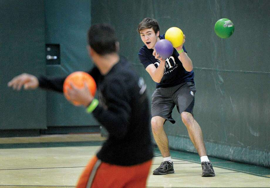Hour Photo/Alex von Kleydorff Erit Montero with the ROTC 'B' team throws and missesTeddy Gill with Team Sister City, but would hit him with the next throw for the win, as he was the last man standing on his team during Dodgeball tournament fundraiser at Norwalk High School