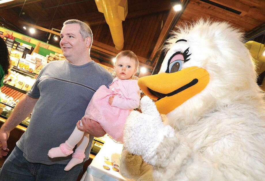 Hour Photo/Alex von Kleydorff Doug Beyers holds on to 16 month old Darien as they meet Cynthia Chick during Stew Leonard's Eggs-Travaganza Easter Egg Hunt on Tuesday