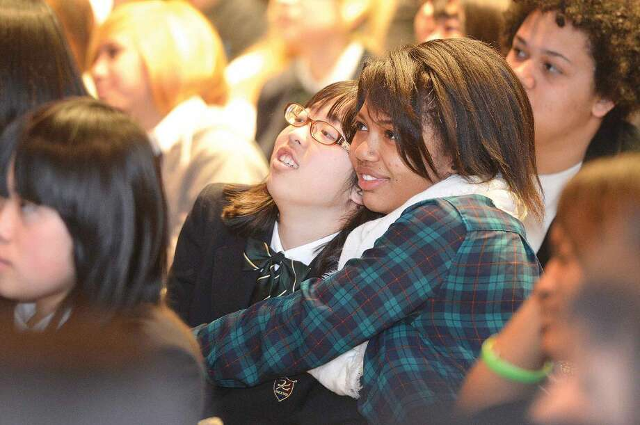 Hour Photo/Alex von Kleydorff Brien McMahon's Cyndrina Jean-Charles gives a hug to friend and Kojo High School student Yuno Okada during a program to celebrate 20 years of International Exchanges at the Center for Global Studies at Brien McMahon High School