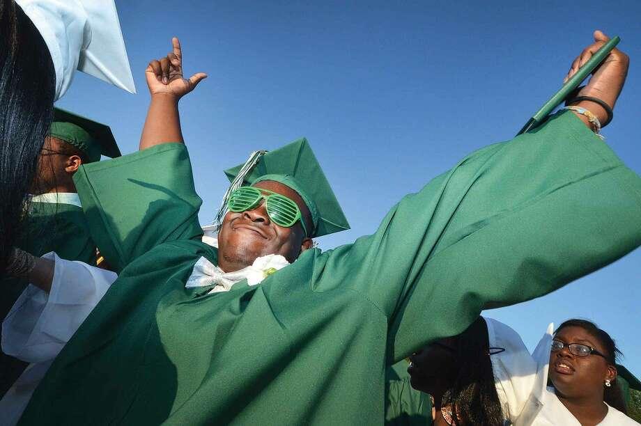 Hour Photo/Alex von Kleydorff Khalil Williams celebrates with diploma in hand during Norwalk High School Class of 2014 Graduation