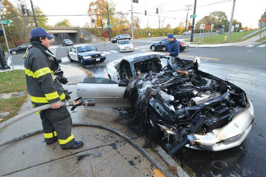 Hour Photo/Alex von Kleydorff Norwalk Firefighters respond and extiguish a car on fire on Maple Street Late Monday afternoon