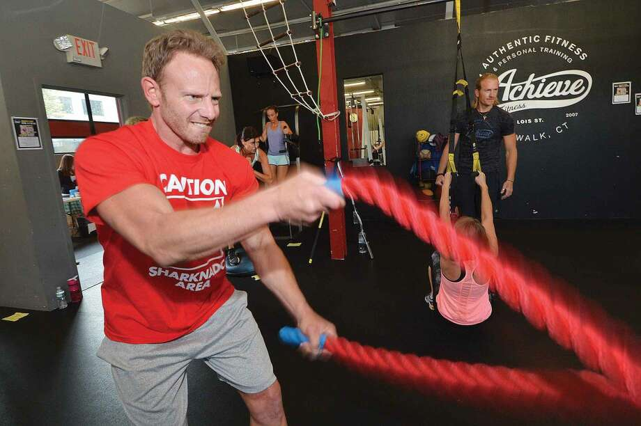 Hour Photo/Alex von Kleydorff Sharknado Actor Ian Ziering works on the 'Battling Ropes' while leading a 'Boot Camp With a Cause' at Achive Fitness in Norwalk Ct. on Thursday July 31st. Along with Achive owner Andrew Kindt the funds raised from the strength trainning workout will benefit 'Nourish The Children', (millionsofmeals.com) to help stop malnutrition.