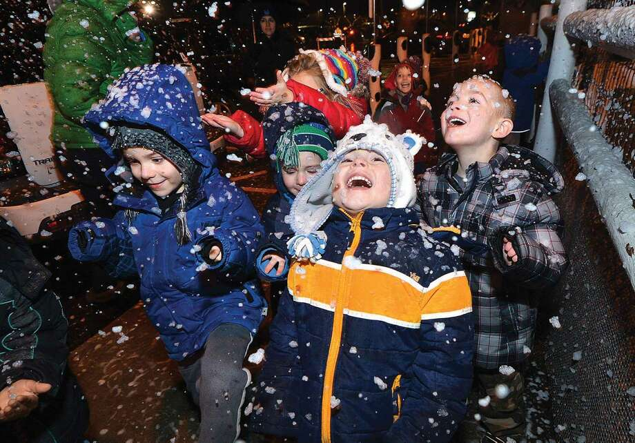 Hour Photo/Alex von Kleydorff 5 yr old Bryson Antoci trys to grab snowflakes falling from snow makers during the Christmas Tree Llighting at Stew Leonard's on Tuesday night