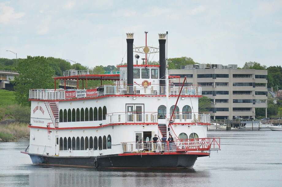 Hour Photo/Alex von Kleydorff The Island Belle makes its way Down the Norwalk River on Monday