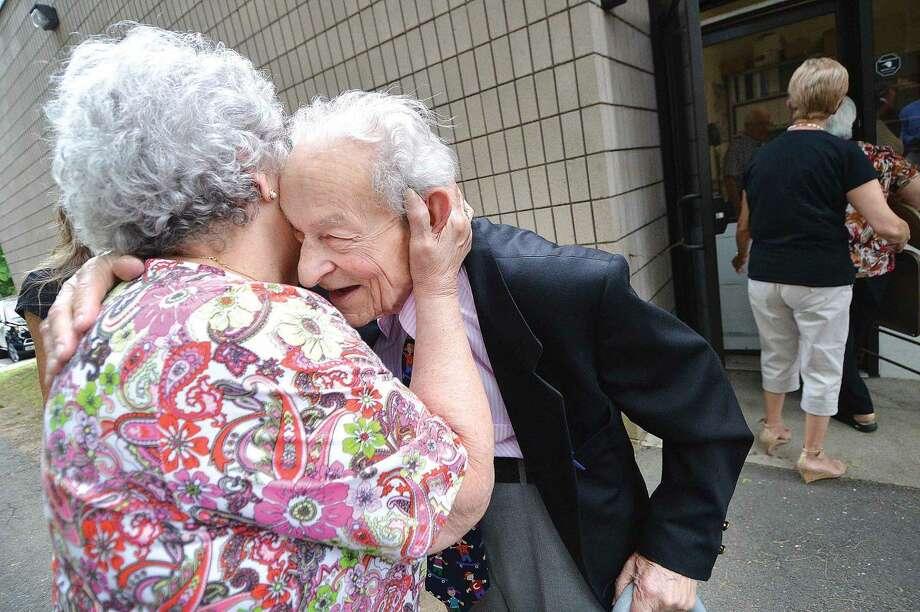 Hour Photo/Alex von Kleydorff Frank Harris gets a big hug from Kay Tortorella who was the Norwalk High School Food Service Manager for 37 years