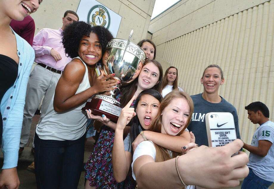 Hour Photo/Alex von Kleydorff Greta McConnell shoots a selfie of her and other team capatians with the Hour Cup at Norwalk High School