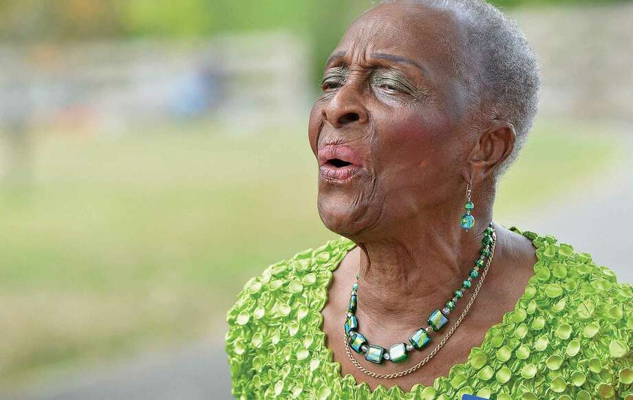 Hour Photo/Alex von Kleydorff 92 year old Blanche Sumpter who had family that survived from Tower 1 sings along with God Bless america at Stamford's Ceremony to Honor the Victims of the 9/11 World trade Center Tragedy