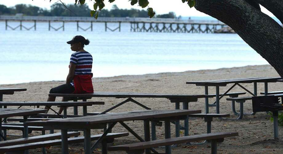 Hour Photo/Alex von Kleydorff Sarah Penn enjoys a quiet moment at Shady Beach on Monday, the official last day of summer