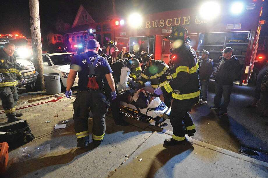 Hour Photo/Alex von Kleydorff Emergency personnel place a man on a gurney after pulling him from underneath a pick up that crashed into the wall at 50 Woodward Ave on Friday night