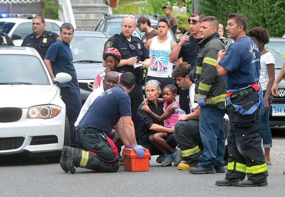 Hour Photo/Alex von Kleydorff Emergency personnel arrive as a young girl is comforted after she was involved in a collision with a passing car on Osborne Ave Friday afternoon