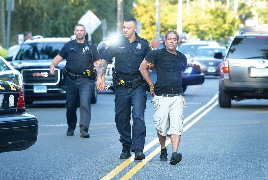 Hour Photo/Alex von Kleydorff Norwalk Police investigate a reported shooting on St John St. on Friday evening