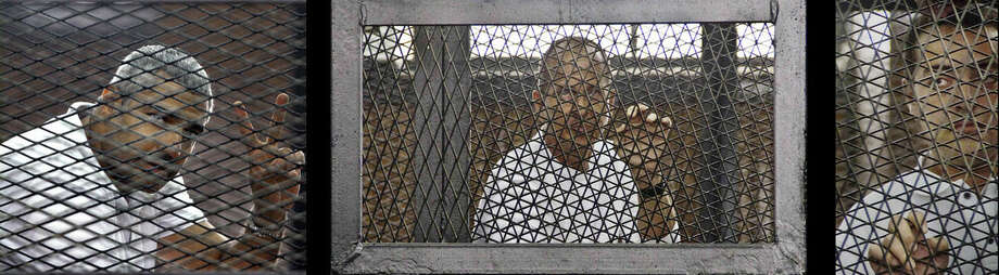 FILE - This combination of three 2014 file photos shows from left, Canadian-Egyptian journalist Mohamed Fahmy, Al-Jazeera's Australian correspondent Peter Greste, and Egyptian producer Baher Mohamed at a court room during their trial in Cairo, Egypt. A year after three Al-Jazeera English journalists were arrested in Egypt, they and their families are pleading for justice and an end to their ordeal. Egypt's Court of Cassation begins hearing their appeal on Thursday, Jan. 1, 2015.(AP Photo/Ahmed Abd El Latif, Hamada Elrasam, File) EGYPT OUT