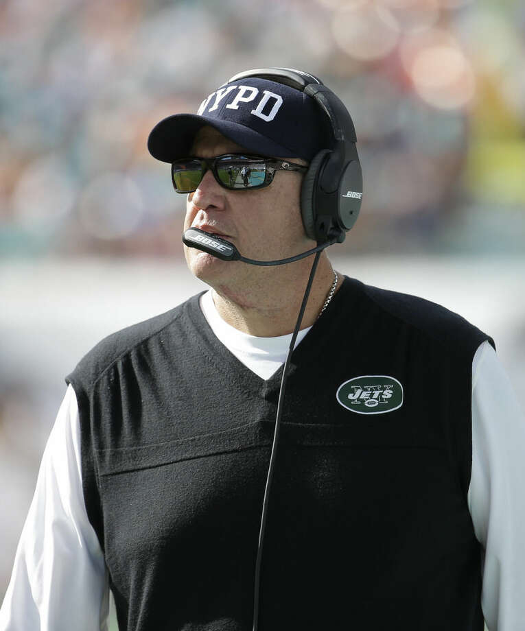 New York Jets head coach Rex Ryan walks the sidelines during the first half of an NFL football game against the Miami Dolphins, Sunday, Dec. 28, 2014, in Miami Gardens, Fla. (AP Photo/Lynne Sladky)