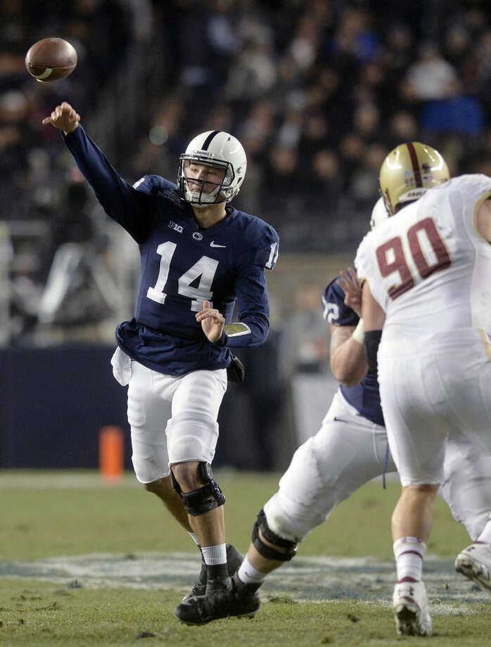 Penn State quarterback Christian Hackenberg (14) throws a pass against Boston College in the first half of the Pinstripe Bowl NCAA college football game on Saturday, Dec. 27, 2014, in New York. (AP Photo/York Daily Record, Chris Dunn) YORK DISPATCH OUT