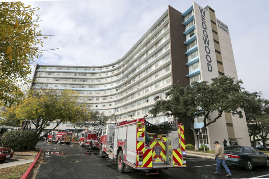 Firefighters and emergency units respond to a fire at the Wedgwood Senior Apartments, Sunday, Dec. 28, 2014 in San Antonio, Texas. Five people died after a fire broke out at the senior-living apartment building in the San Antonio suburb of Castle Hills, authorities said. (AP Photo/San Antonio Express-News, Marvin Pfeiffer)