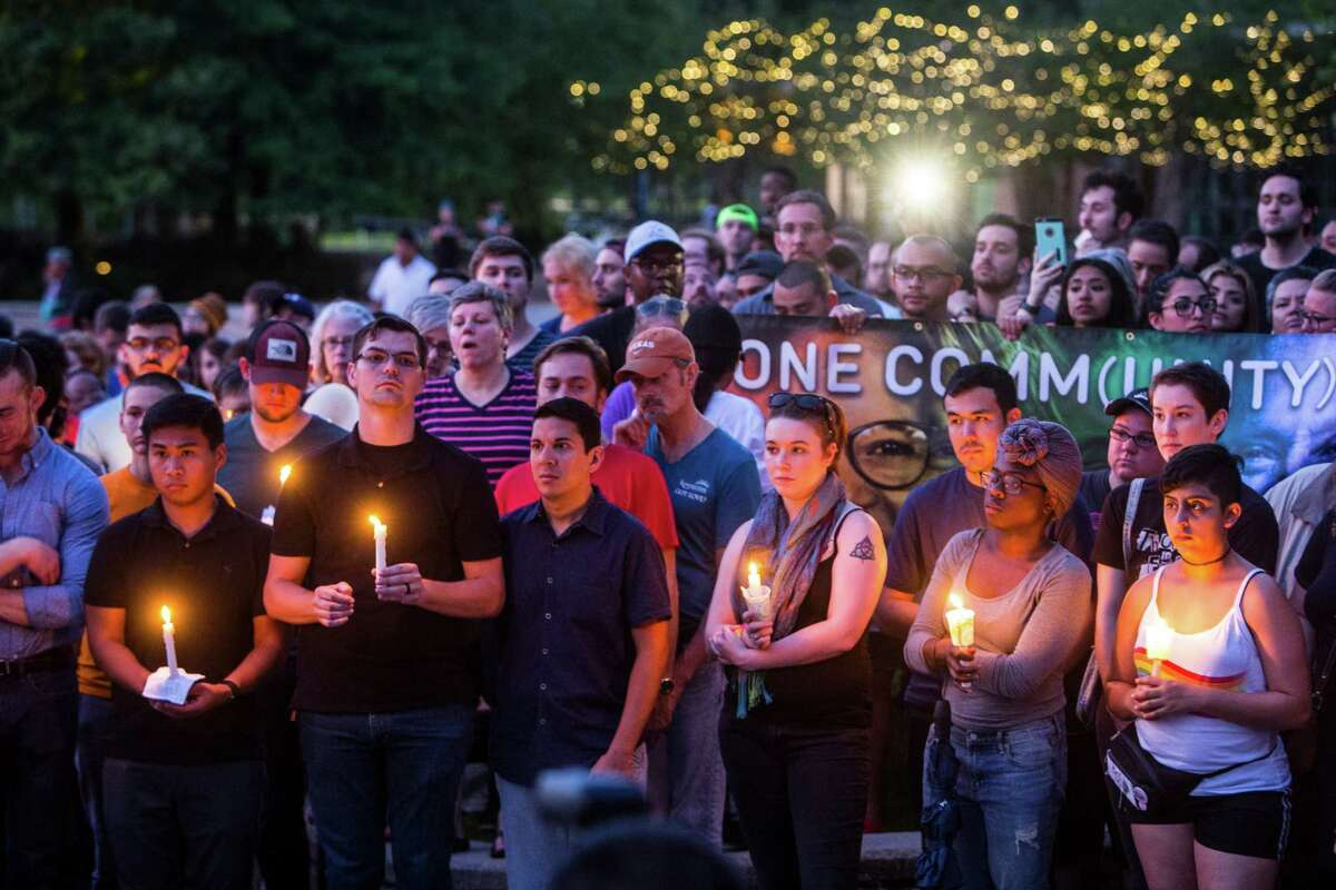 More than 100 people gathered Sunday evening as the sun set outside the Houston Zoo for a vigil in honor of the Orlando massacre victims.