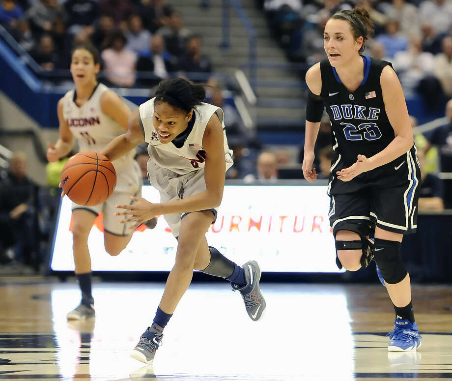 Connecticut's Moriah Jefferson, picks off the ball from Duke's Rebecca Greenwell, right, during the second half of an NCAA college basketball game, Monday, Dec. 29, 2014, in Hartford, Conn. Jefferson had 18 points as Connecticut defeated Duke 83-52. (AP Photo/Jessica Hill)