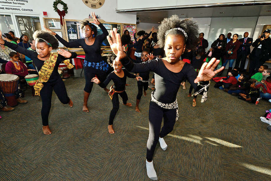 Hour photo / Erik Trautmann The Dance Like David Dancers perform in Stamford's 20th annual Kwanzaa celebration Tuesday at the Stamford Government Center.