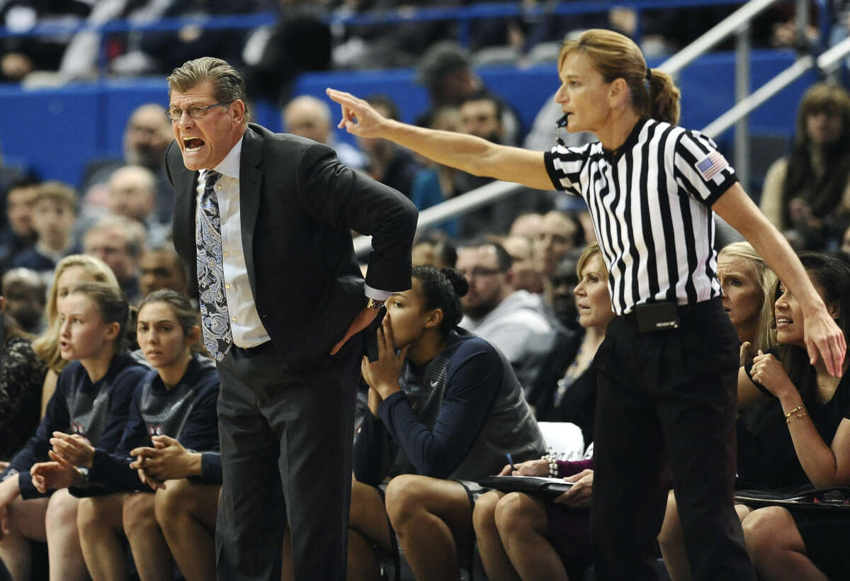 Connecticut head coach Geno Auriemma calls out to his team as official Dee Kantner, right, watches play during the first half of an NCAA college basketball game against Duke, Monday, Dec. 29, 2014, in Hartford, Conn. (AP Photo/Jessica Hill)