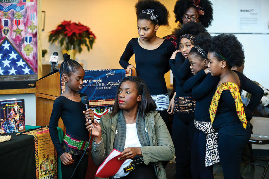 Hour photo / Erik Trautmann The Dance Like David Dancers participate in Stamford's 20th annual Kwanzaa celebration Tuesday at the Stamford Government Center.