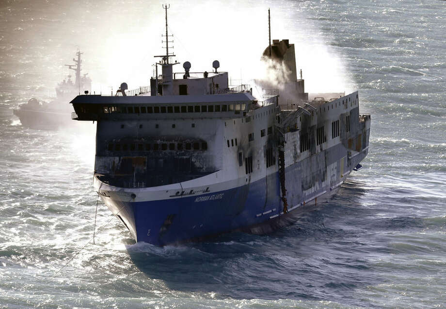 "Smoke billows from the Italian-flagged Norman Atlantic ferry that caught fire in the Adriatic Sea, Tuesday, Dec. 30, 2014. A blaze broke out on the car deck of the Norman Atlantic Sunday, Dec. 28, while the ferry was traveling from the Greek port of Patras to Ancona in Italy causing the death of at least 11 people. Italian and Greek helicopter rescue crews evacuated 427 people among passengers and crew members but Italian officials think the death toll could be much higher because of serious discrepancies in the ship's manifest and confusion over how many people were aboard. ""We cannot say how many people may be missing,"" Italian Transport Minister Maurizio Lupi said at a news conference. The cause of the fire is under investigation. (AP Photo/Antonio Calanni)"
