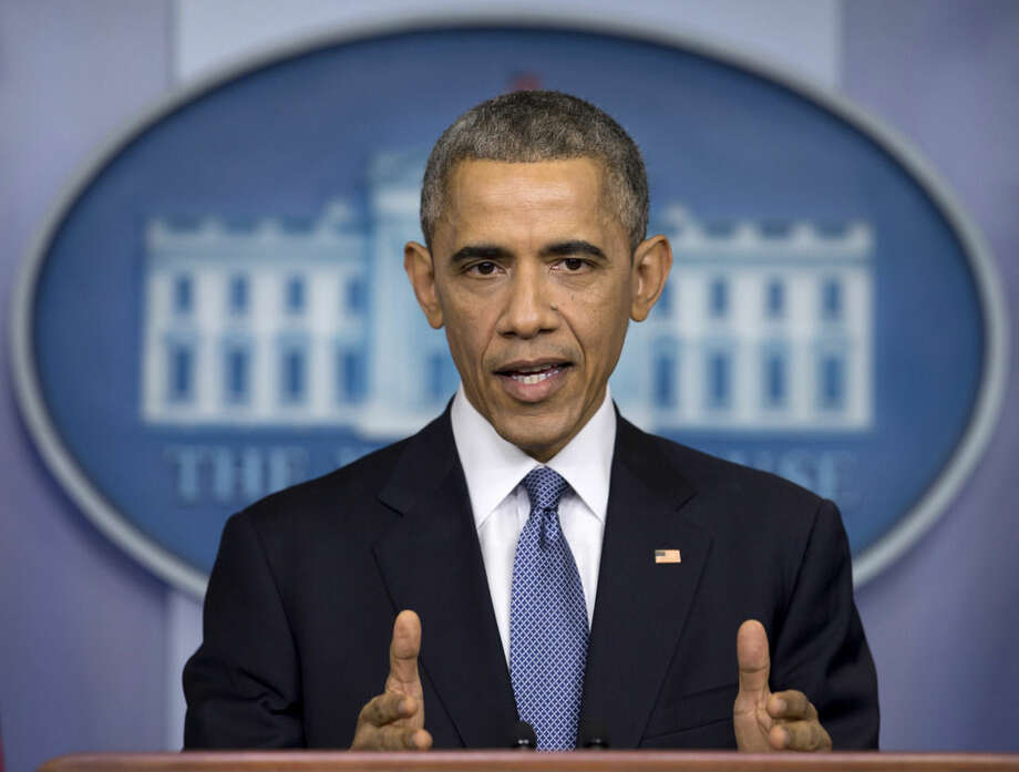 AP Photo/Carolyn Kaster, FilEIn this Dec. 19, 2014 file photo, President Barack Obama speaks during a news conference in the Brady Press Briefing Room of the White House in Washington to talk about successes in 2014, citing lower unemployment, a rising number of Americans covered by health insurance, and an historic diplomatic opening with Cuba.