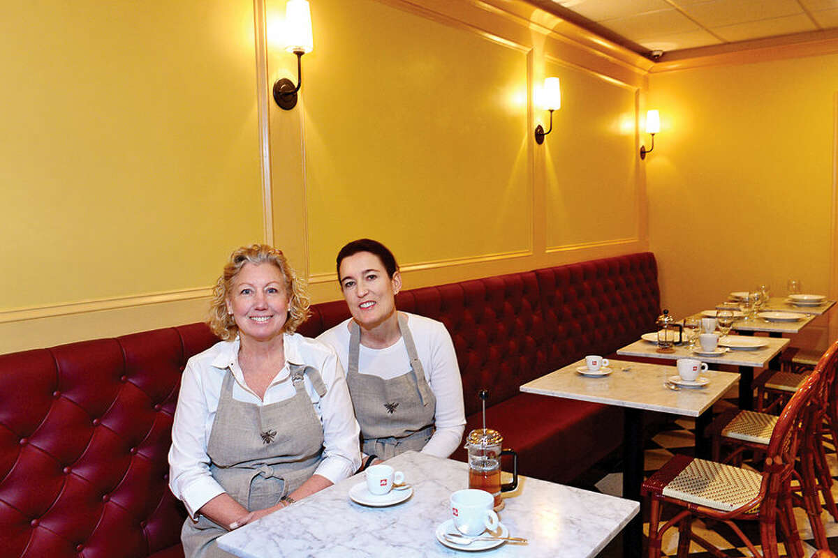 Barbara Chopin and Annie Horn, inside the dining area of Café Ruche.