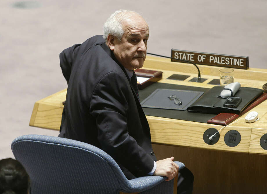 Palestinian Ambassador to the United Nations Riyad Mansour waits for the start of a meeting of the U.N. Security Council Tuesday, Dec. 30, 2014, at the United Nations headquarters. The U.N. Security Council scheduled a vote Tuesday evening on a Palestinian resolution calling for an end to Israel's occupation within three years, a proposal virtually certain to be defeated because of U.S. and Israeli opposition. (AP Photo/Frank Franklin II)