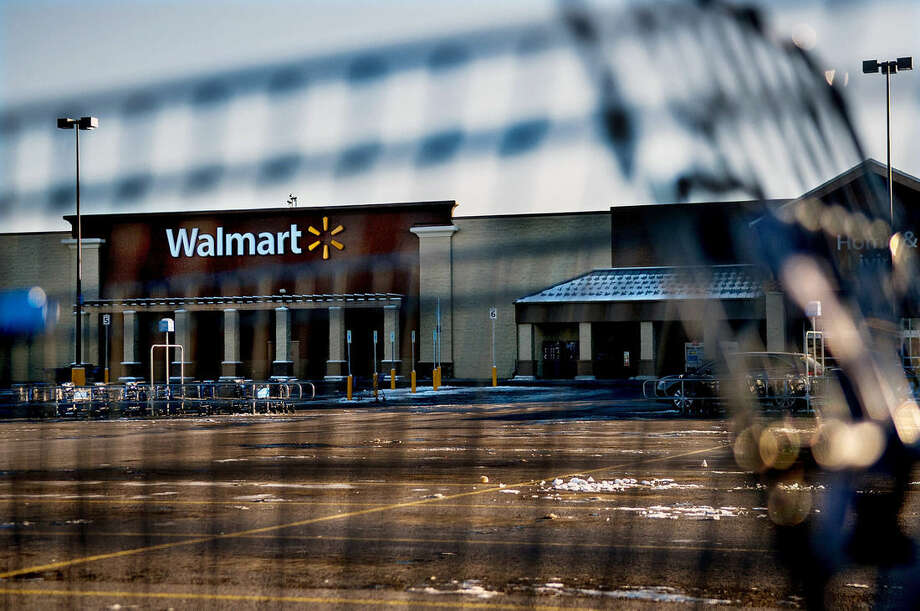 This photo shows Wal-Mart with a shopping cart in the foreground in Hayden, Idaho, Tuesday, Dec. 30, 2014. A 2-year-old boy accidentally shot and killed his mother after he reached into her purse at the northern Idaho Wal-Mart and her concealed gun fired, authorities said Tuesday. (AP Photo/The Spokesman-Review, Kathy Plonka) COEUR D'ALENE PRESS OUT