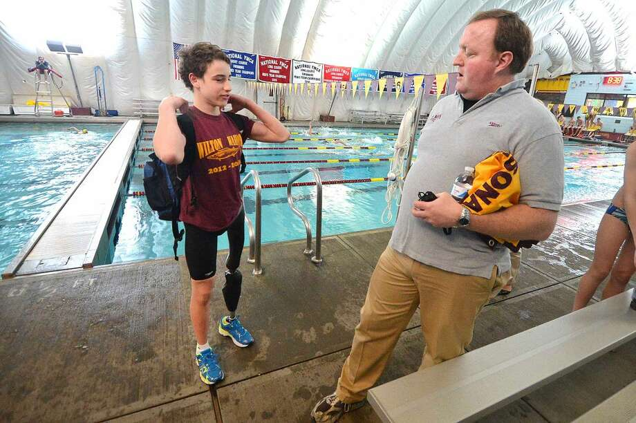 David Gelfand talks with his coach Todd Stevens about the swim suit designed by Speedo for his specific swiiming needs.