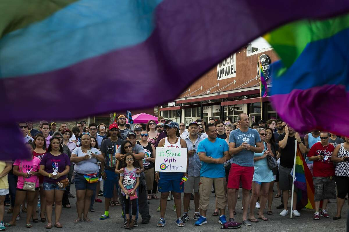 Community members come together following a vigil at Crockett Park in downtown San Antonio in honor of the shooting victims at a gay nightclub in Orlando, Fl., that took the lives of 50 and wounded 53 others in the early hours this morning, on Sunday, June 12, 2016.