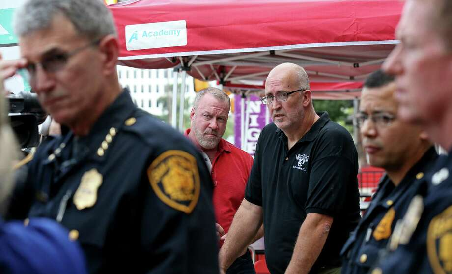 Randy Cunniff president of R.R. Cunniff Investements Inc., (center left) and marketing director Scott Ross (center right) listen to San Antonio Police Chief William McManus answer questions from the media, Sunday June 12, 2016 outside Luther's Cafe, on the local response to the Orlando, Fla. shooting. Cunniff owns Luther's Cafe and other neighborhood businesses. Photo: Edward A. Ornelas, Staff / San Antonio Express-News / © 2016 San Antonio Express-News
