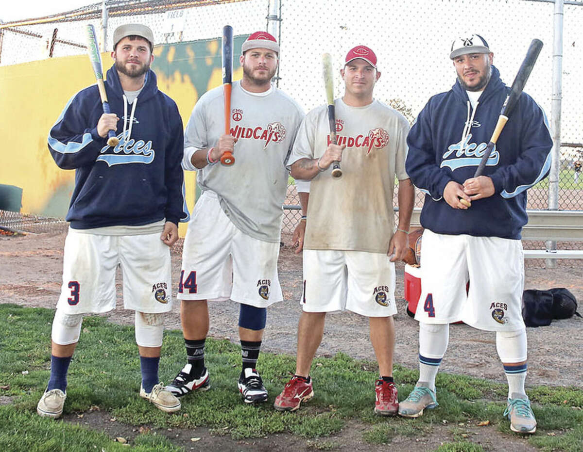 Hour photo/Danielle Calloway The Smith Brothers -- left to right, Drew, Joey, Chris and Donnie -- faced off against one another in this year's city softball championship as the Wildcats beat the Aces.